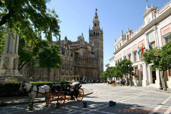 Cathedral view from the Monument dedicated to the Immaculate Conception, Plaza del Triunfo, Seville - Spain, Andalusia