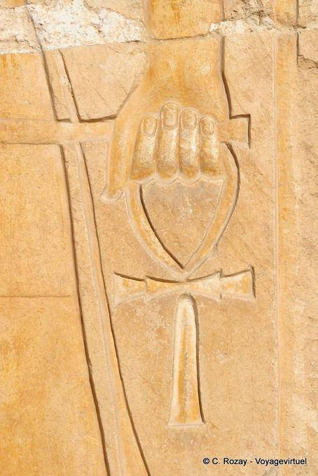 Hand holding the cross of life (or ankh ankh or cross ...