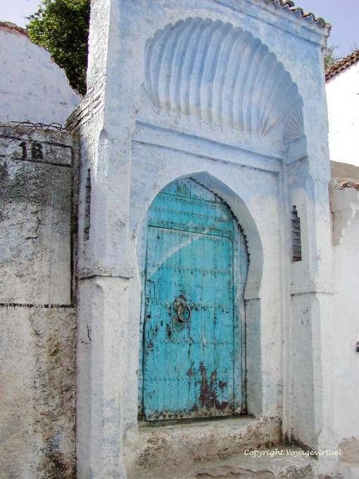 Moorish door and pediment clamshell saint jacques for Clamshell door